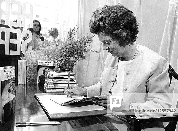 Mary Wilson (b1918) autographs her book of poems at Claude Gill  Oxford Street  London  1970. Artist: Unknown