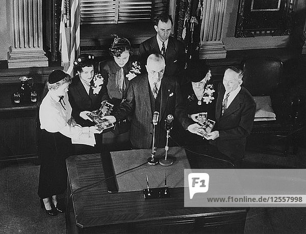 Families receiving Congressional Medals of Honor from President Harry Truman  September 1951. Artist: Unknown