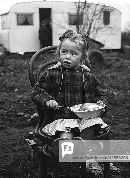 Gipsy girl eating  Lewes  Sussex  1964.