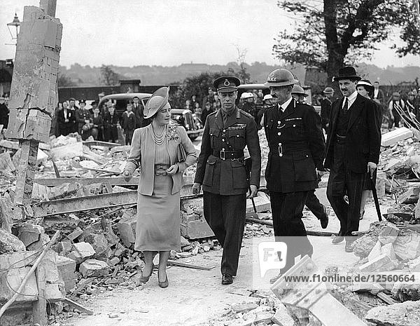 Queen Elizabeth and King George VI inspecting air raid damage  World War II  1940-1945. Artist: Unknown