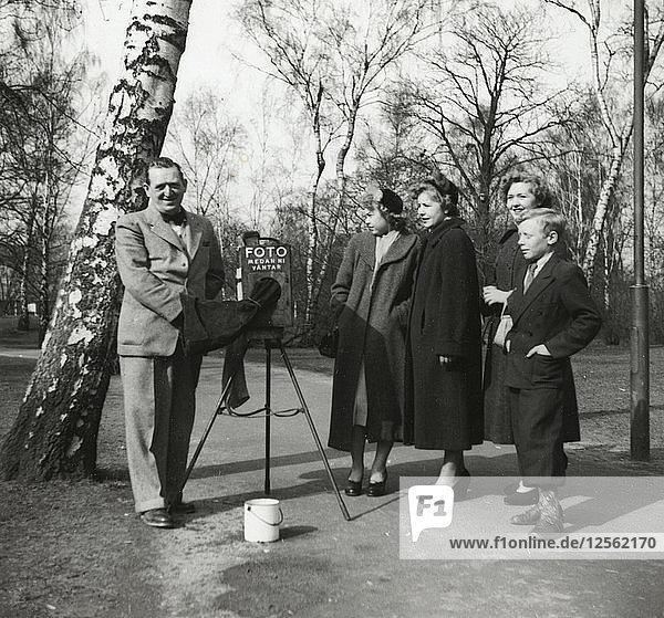 A photographer in a park  Landskrona  Sweden 1952. Artist: Unknown