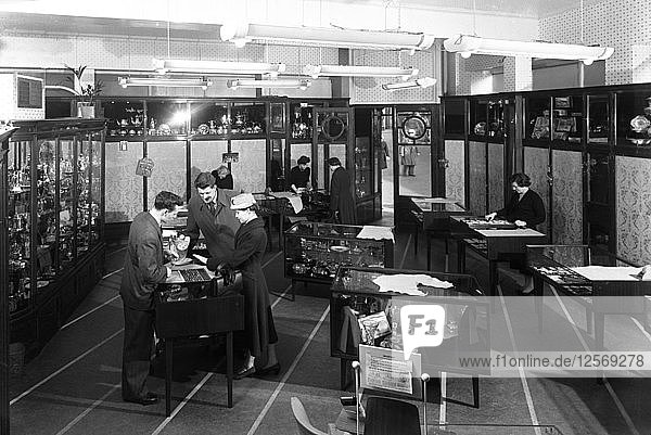 Customers in the Barnsley Co-op jewellery department  South Yorkshire  1957. Artist: Michael Walters