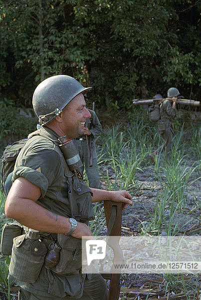 US Marines on patrol  west of Duc Hoa  Vietnam  April 1965. Artist: Unknown