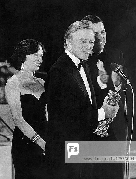 American actor and film star Kirk Douglas holding an award  Paris  France  c1978-c1981. Artist: Unknown