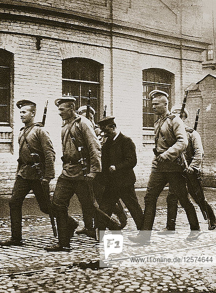 A patrol hunting down suspects following the revolt at Vyborg  Russia  early 20th century. Artist: Unknown