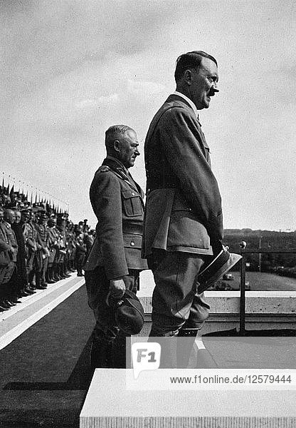 Adolf Hitler with Konstantin Hierl  Nuremberg Rally  Germeny  1935. Artist: Unknown