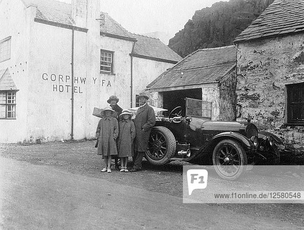 A family standing beside their car  Gorphwysfa Hotel  North Wales  c1920s-c1930s(?). Artist: Unknown