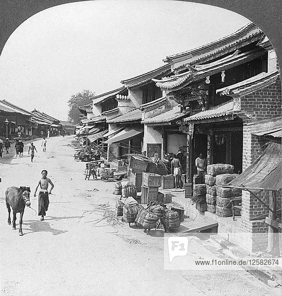 Main business street of the Chinese quarter  Bhamo  Burma  1908. Artist: Stereo Travel Co