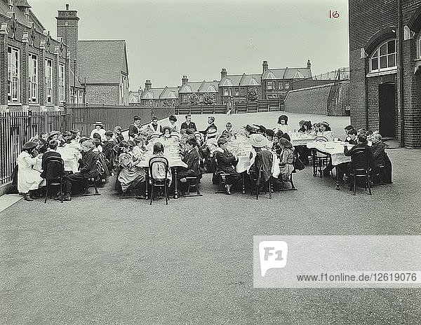 Children eating dinner at tables in the playground  Shrewsbury House Open Air School  London  1908. Artist: Unknown.