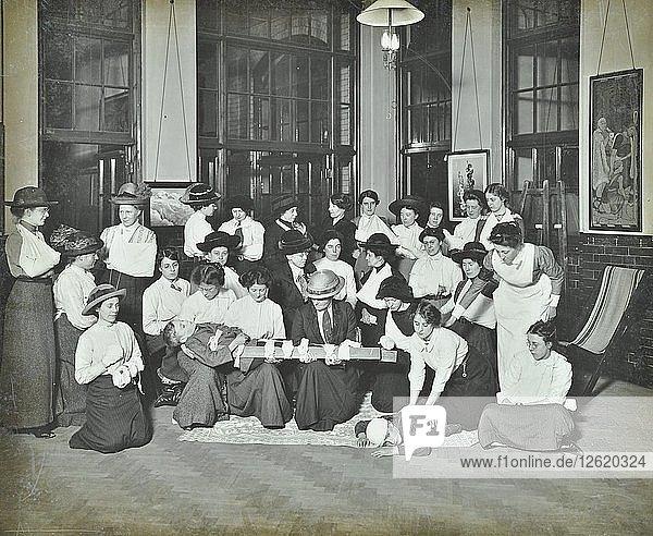 First aid class for women  Montem Street Evening Institute  London  1913. Artist: Unknown.