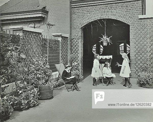 Girls relaxing in a roof top garden  White Lion Street School  London  1912. Artist: Unknown.