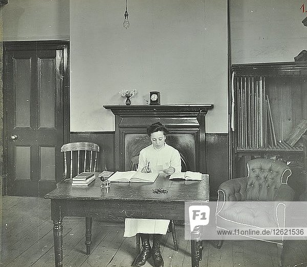 Female student sitting at desk  Shoreditch Technical Institute  London  1907. Artist: Unknown.
