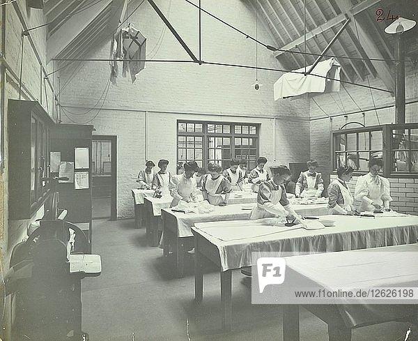 The ironing room  Battersea Polytechnic  London  1907. Artist: Unknown.