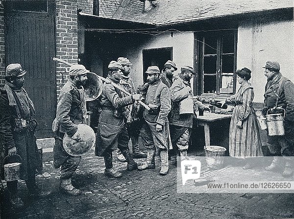 French soldiers returning from the trenches make a halt for refreshment  c1914. Artist: Unknown