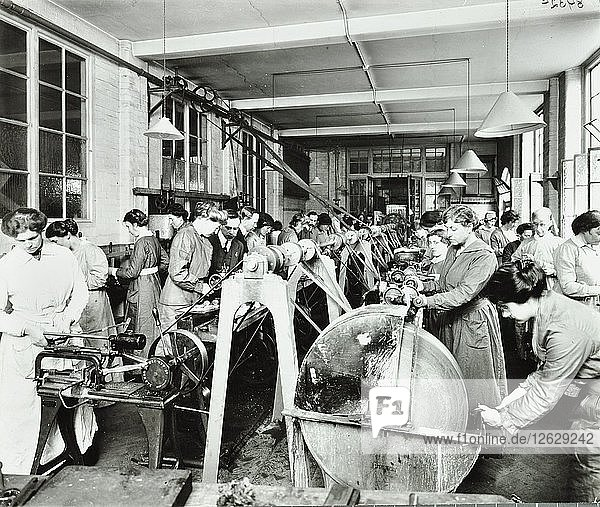 Female munitions workers  Shoreditch Technical Institute  London  1915. Artist: Unknown.