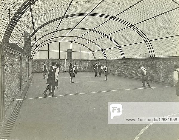 Girls playing netball on a roof playground  Barrett Street Trade School  London  1927. Artist: Unknown.