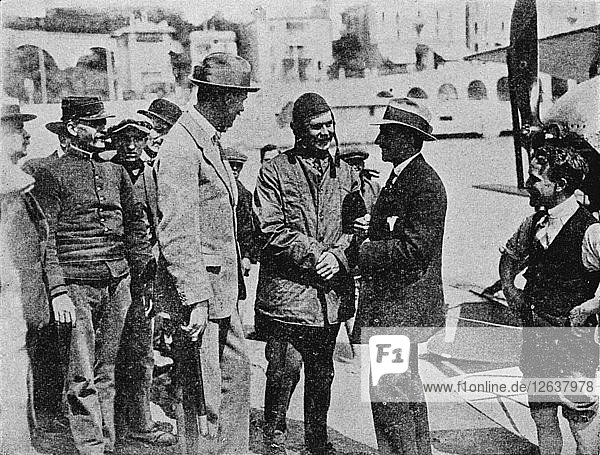 The Schneider Trophy: Howard Pixton talking to Jacques Schneider after his victory  1914 (1934). Artist: Flight Photo.