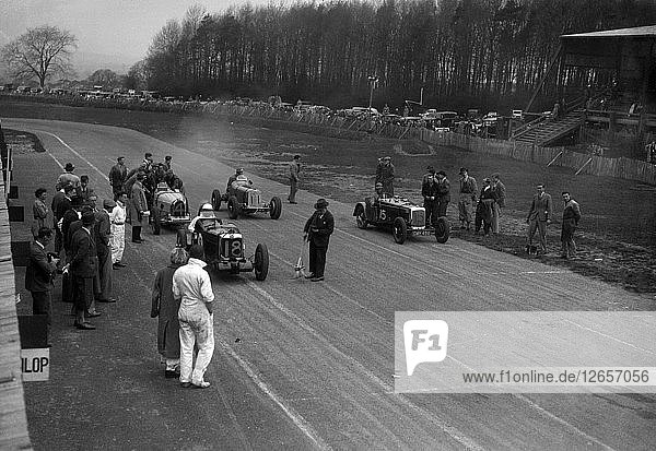 MG Q type  Frazer-Nash Shelsley and Bugatti Type 51 on the starting grid at Donington Park  1930s. Artist: Bill Brunell.