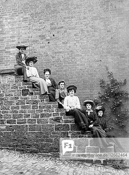 Women sitting on steps of an unidentified building  Hellidon  Northamptonshire  c1896-c1920. Artist: Alfred Newton & Sons.