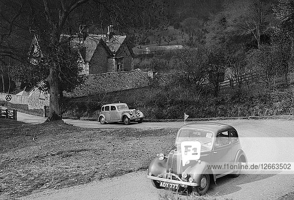 Vauxhall 10 of Miss IM Burton amd Rover of CG Dunham competing in the RAC Rally  1939. Artist: Bill Brunell.