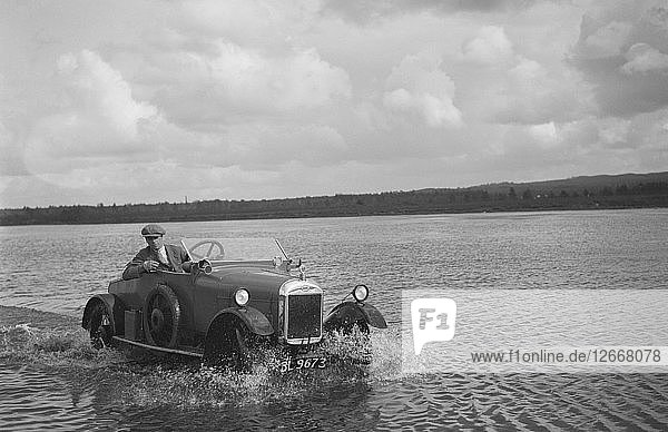 HG Pope driving a GWK through water at a demonstration event  Frensham Common Pond  Surrey  1922. Artist: Bill Brunell.