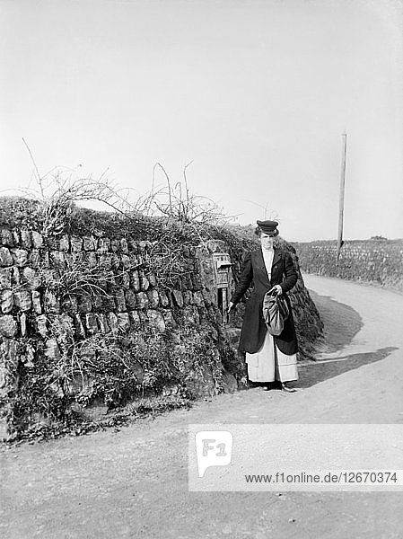 Postwoman emptying a postbox at an unidentified location in Kerrier  Cornwall  1901. Artist: Alfred Newton & Sons.