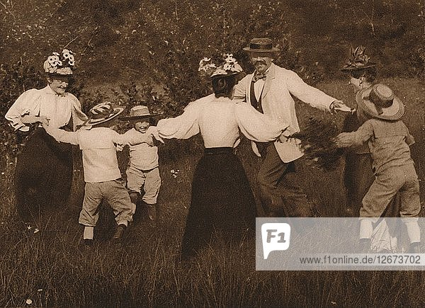 Family playing games in a field  1937. Artist: Unknown.
