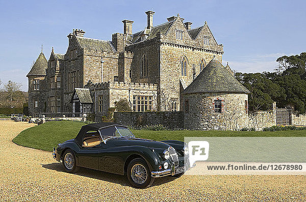 1954 Jaguar XK140 outside Palace House  Beaulieu Artist: Unknown.