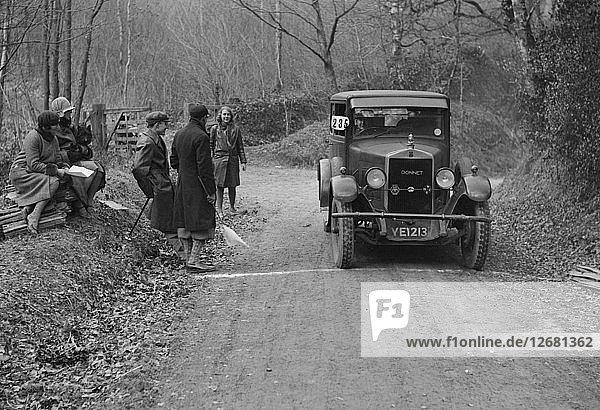 Kittu Brunell watching a Donnet competing in the Sunbeam Motor Car Club Bognor Trial  1929. Artist: Bill Brunell.