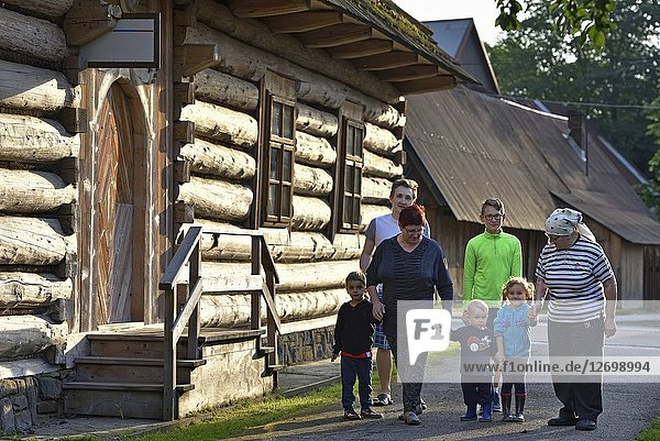 Family in the village of Chocholow  Podhale region  Malopolska Province (Lesser Poland)  Poland  Central Europe.