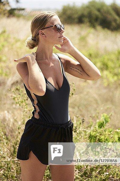 Cool woman standing in nature in Malia  Crete  Greece