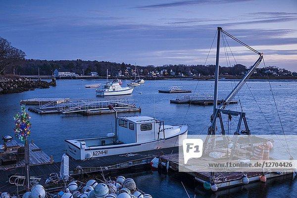 USA  New England  Cape Ann  Massachusetts  Annisquam  Annisquam Harbor  harbor with small Christmas Tree  dusk.
