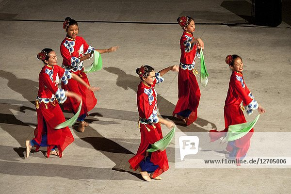 A Chinese American dance group performs 'Joyful Reunion' at a celebration of Chinese New Year in Costa Mesa  CA.