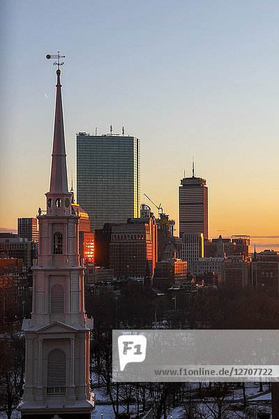 Park Street Church steeple and skyscrapers at sunset  Boston  Massachusetts  United States.