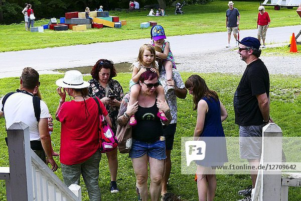 Wassaic  New York  USA Families and people arriving at a local summer festival.