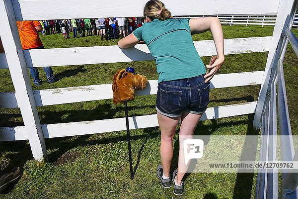 Litchfield  Connecticut  USA A woman watches a 4-H awards ceremony at the Litchfield County Fairgrounds.