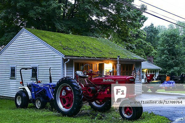 Goshen  Connecticut  USA Two classic tractors parked outside a house.