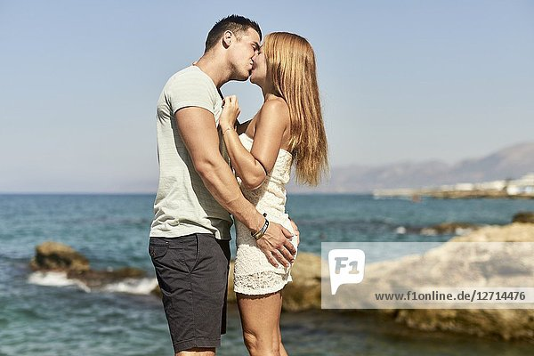 Couple in summer holiday  kissing. Crete  Greece.
