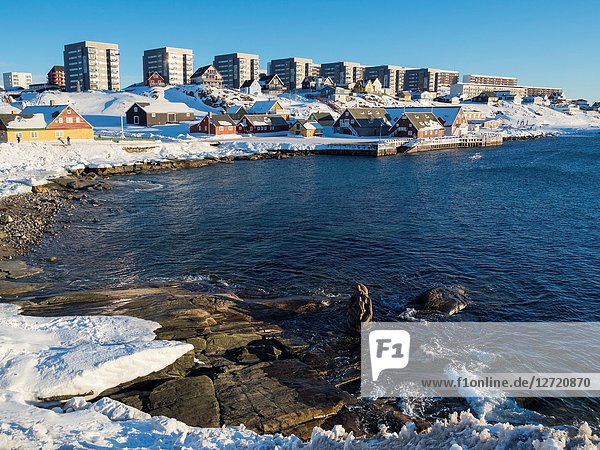 View over the old town and the colonial harbour towards the modern quarters of Nuuk. Nuuk  the capital of Greenland. America  North America  Greenland.