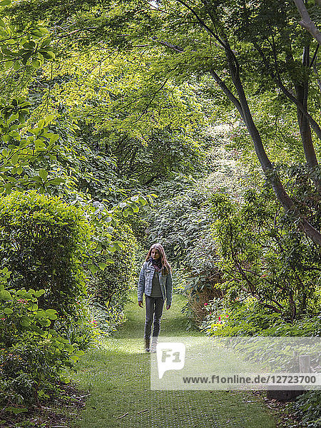 Young girl walking in a park