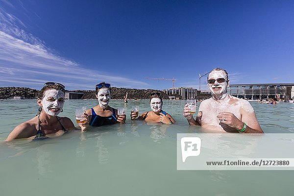 Guests enjoy the thermal waters and mud treatments of the Blue Lagoon  BlaÌ. a loÌ. nið   Iceland.