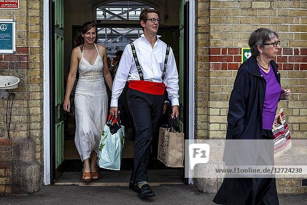 Young opera fans arrive at Lewes Station enroute to Glyndebourne Opera House to see a performance of Vanessa  Lewes  Sussex  UK.