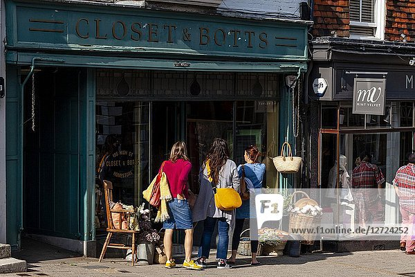 A Group Of Women Shopping At Closet and Botts Homeware Store  High Street  Lewes  East Sussex  UK.