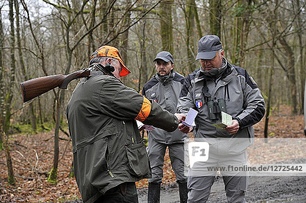 France  hunting and security  officers of French environmental policy controlling hunter during a hunt in Loire-Atlantique Department.