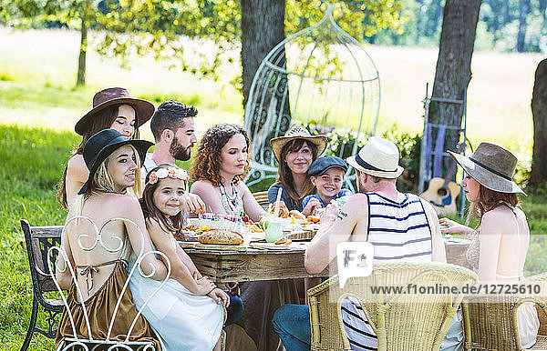 Group of young people seated at a brunch in the country. Mandatory credit: Design culinaire : food-design-studio.fr