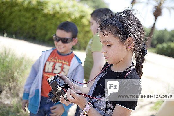 Palestinian children taking photos inside the project Correspondences which put during one year in link a 1st year of primary school of the school Saint Joseph of Lyon and the children going to remedial classes course dispensed by the association Beit Atf
