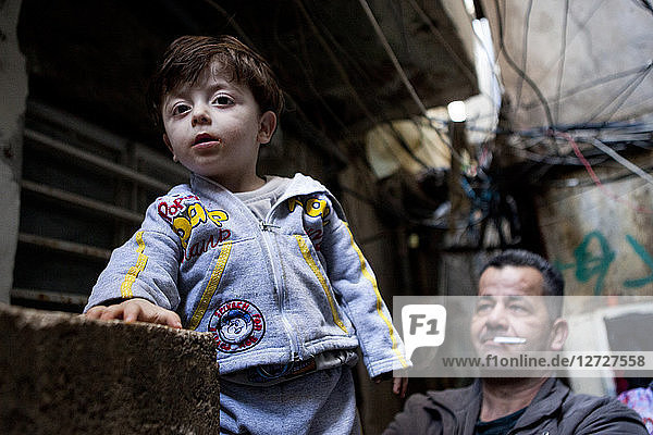Portrait of a boy and his father  Palestinian camp of Shatila  Beirut  Lebanon
