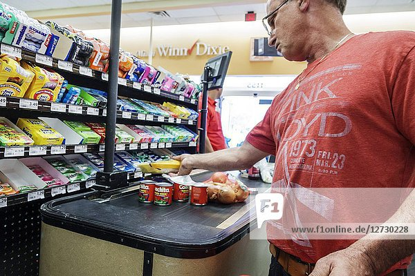 Florida  Miami  Winn Dixie  grocery store supermarket  interior  food  checkout line queue  cashier  customer  man