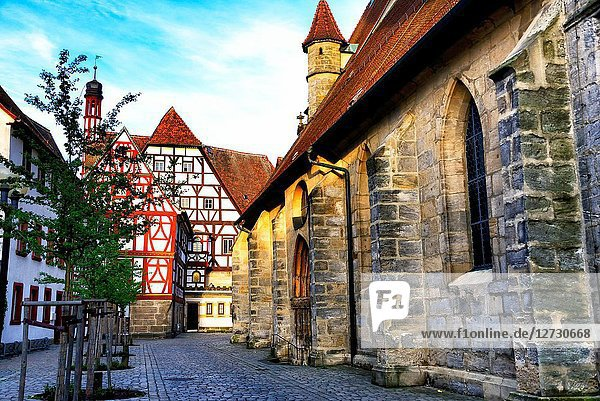 Foreground right - St. Martin church  St.Martin Strasse  in background clock-tower and part of Town Hall  historic part of Forchheim  Forchheim  Franconian Switzerland  Upper Franconia  Franconia  Bavaria  Germany  Europe