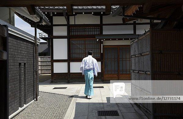 A shinto priest at Fushimi Inari  Kyoto  Japan  Asia.